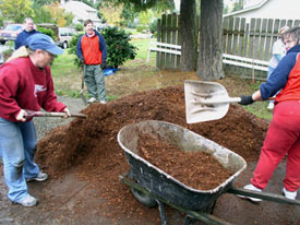GreenCare volunteers help out with a mulching project. (Photo courtesy of GreenCare.)